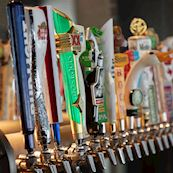 Row of beer taps at the bar
