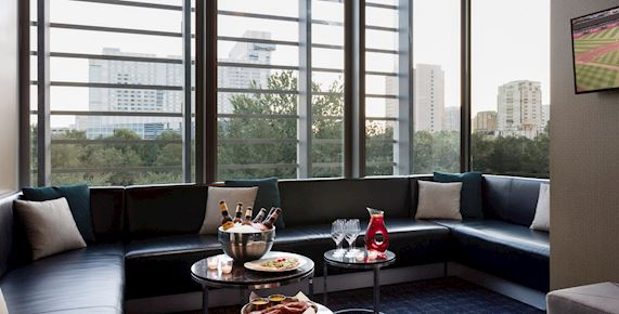 bench seating around a window with coffee tables for food and drinks